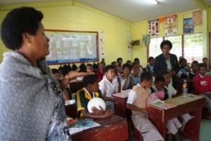 Our students present the children's story books and sports equipment we brought to their Fijian friends