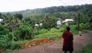 Fiji Projects Coordinator Joe, (and Timothy) lead the way down into the valley where the fishing village is
